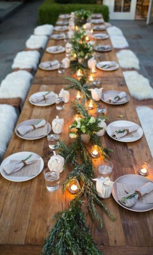 02-a-natural-tablescape-with-a-greenery-runner-candles-in-lanterns-and-napkins-some-white-blooms-for-a-festive-feel