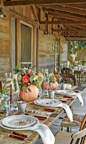 03-natural-fall-centerpieces-with-pumpkin-vases-orange-blooms-feathers-and-greenery-for-Thanksgiving