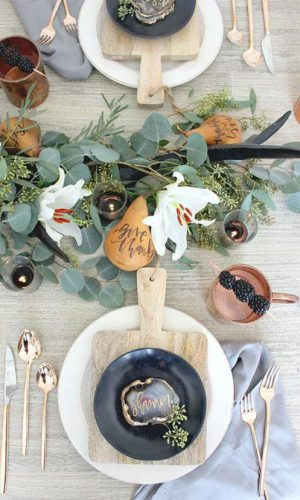 04-a-natural-greenery-centerpiece-with-blooms-pears-and-candles-in-candle-holders-for-a-cozy-feel