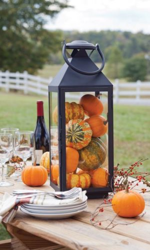 05-a-lantern-centerpiece-is-ideal-for-an-outdoor-dinner-fill-it-with-pumpkins-and-gourds
