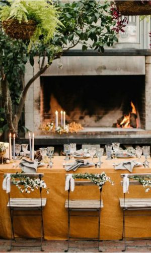 11-a-very-cozy-table-setting-placed-in-a-patio-with-a-fireplace-which-will-keep-you-warm-when-its-getting-later